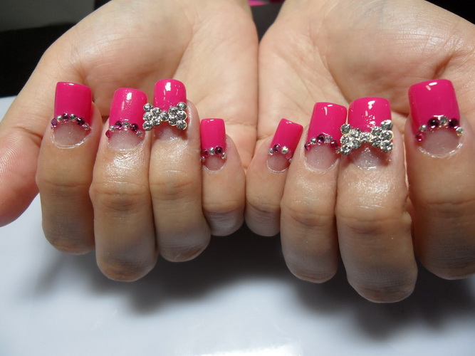 pink acrylic nails with ribbon