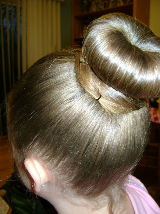 Ballerina buns Top 10 cute girl hairstyles for school