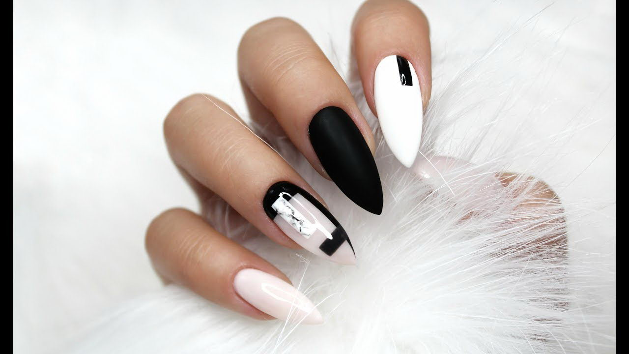Alternating white and black Nails