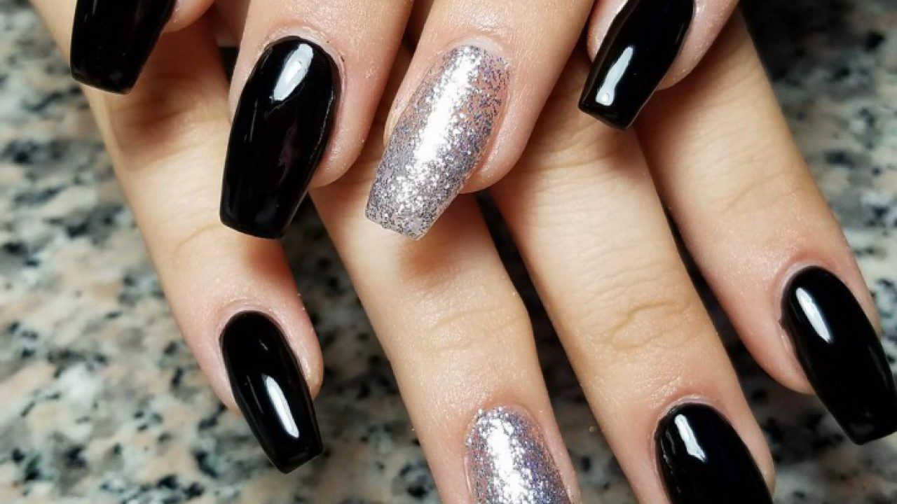 White and also sparkly black Nails Art