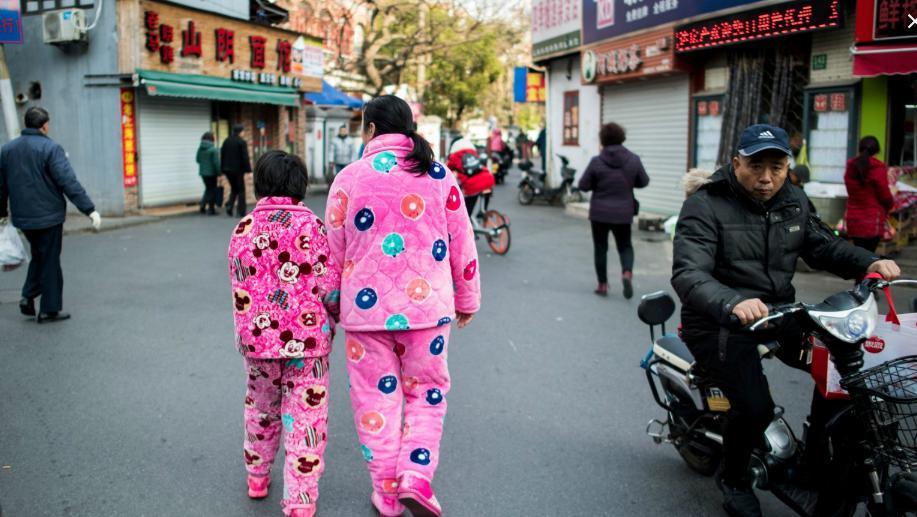 Chinese individuals put on pajamas