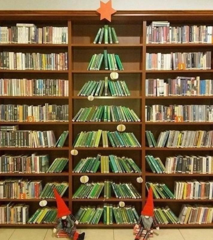 This gorgeous Christmas tree made from books on the shelves was created in a public library