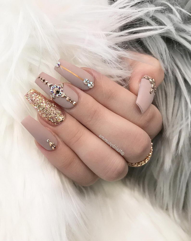 light pink nails with gems