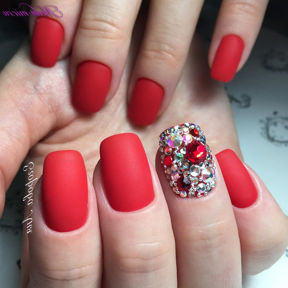 red nails with gems