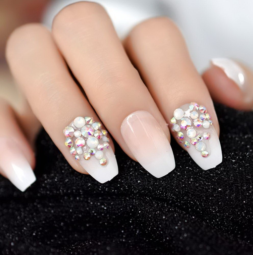 white fake nails with diamonds