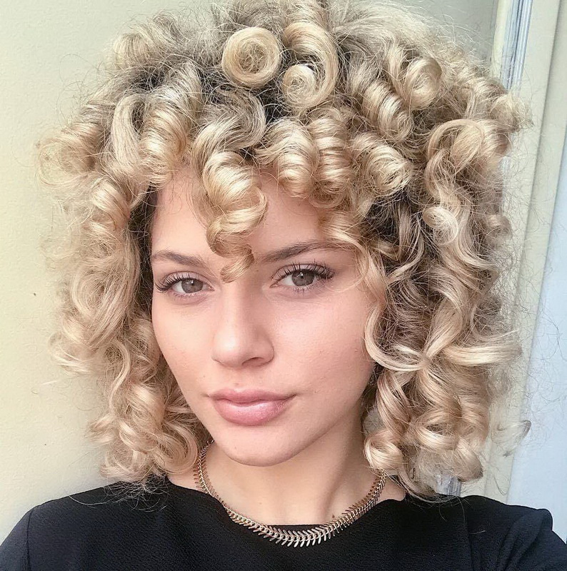curly haircuts for round faces