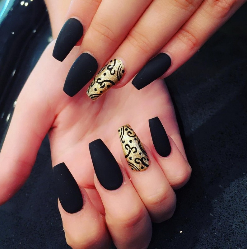 elegant black and gold nails