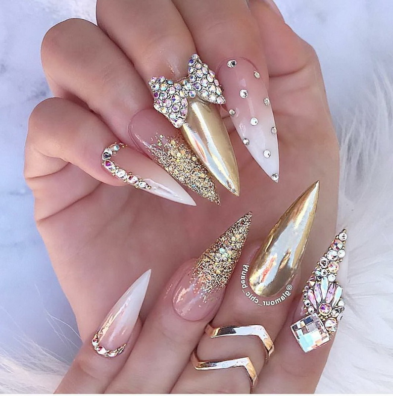 elegant gold stiletto nails
