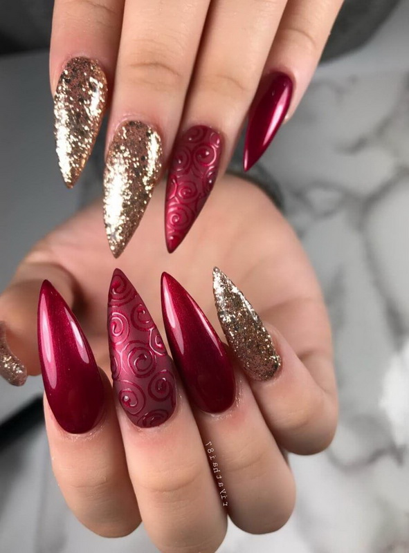 elegant red and gold nails