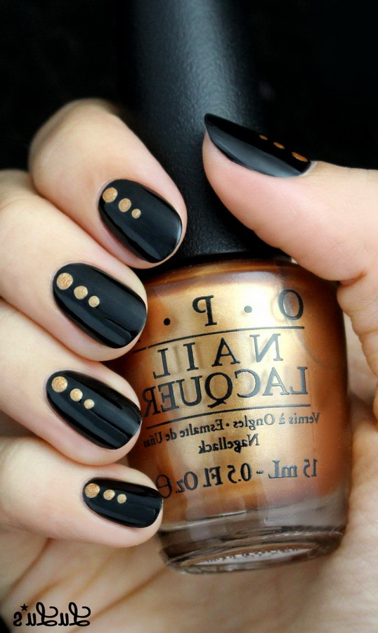 fancy black and gold nails