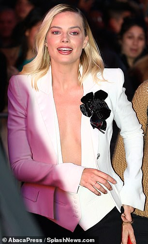 Classy, too:The Australian-born blonde accessorized with a fabulous black corsage on the lapel of her blazer