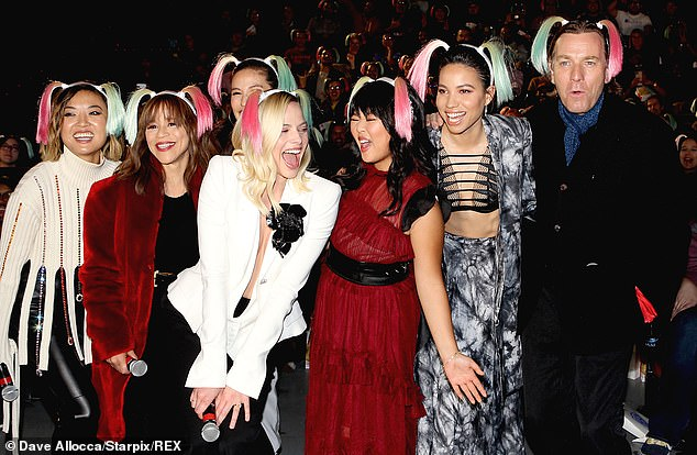 The crew: Joining them were director Cathy Yan (far left),Rosie Perez (second from left) and Ella Jay Basco (third from right)
