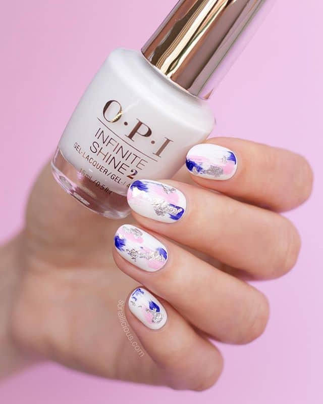 White Nails with Blue and Pink Designs