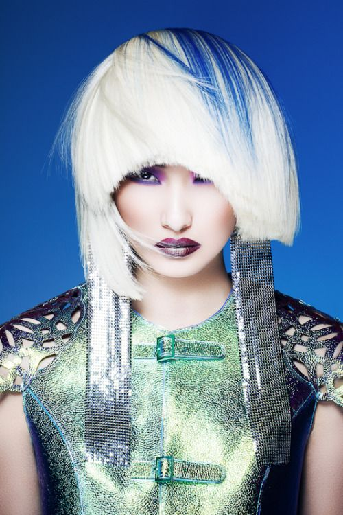 A cyber punk crop style for ladies with streaks of blue and front hair shaded cotton white
