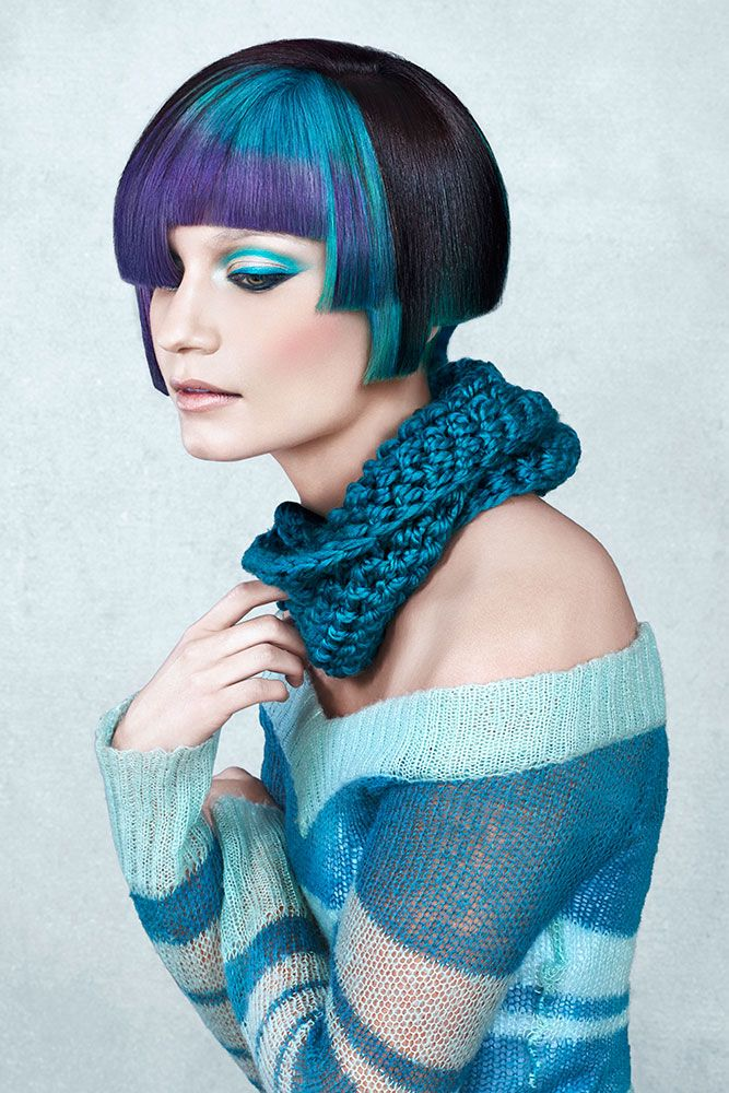 A bob haircut dyed in electric cyan and strikes of black