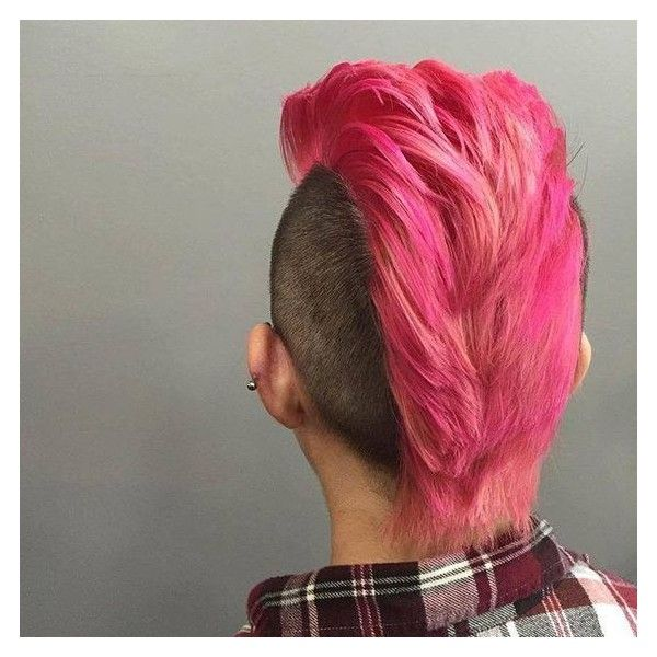 Cyberpunk cut for women with long Mohawk shaded auburn and faded sides hued black