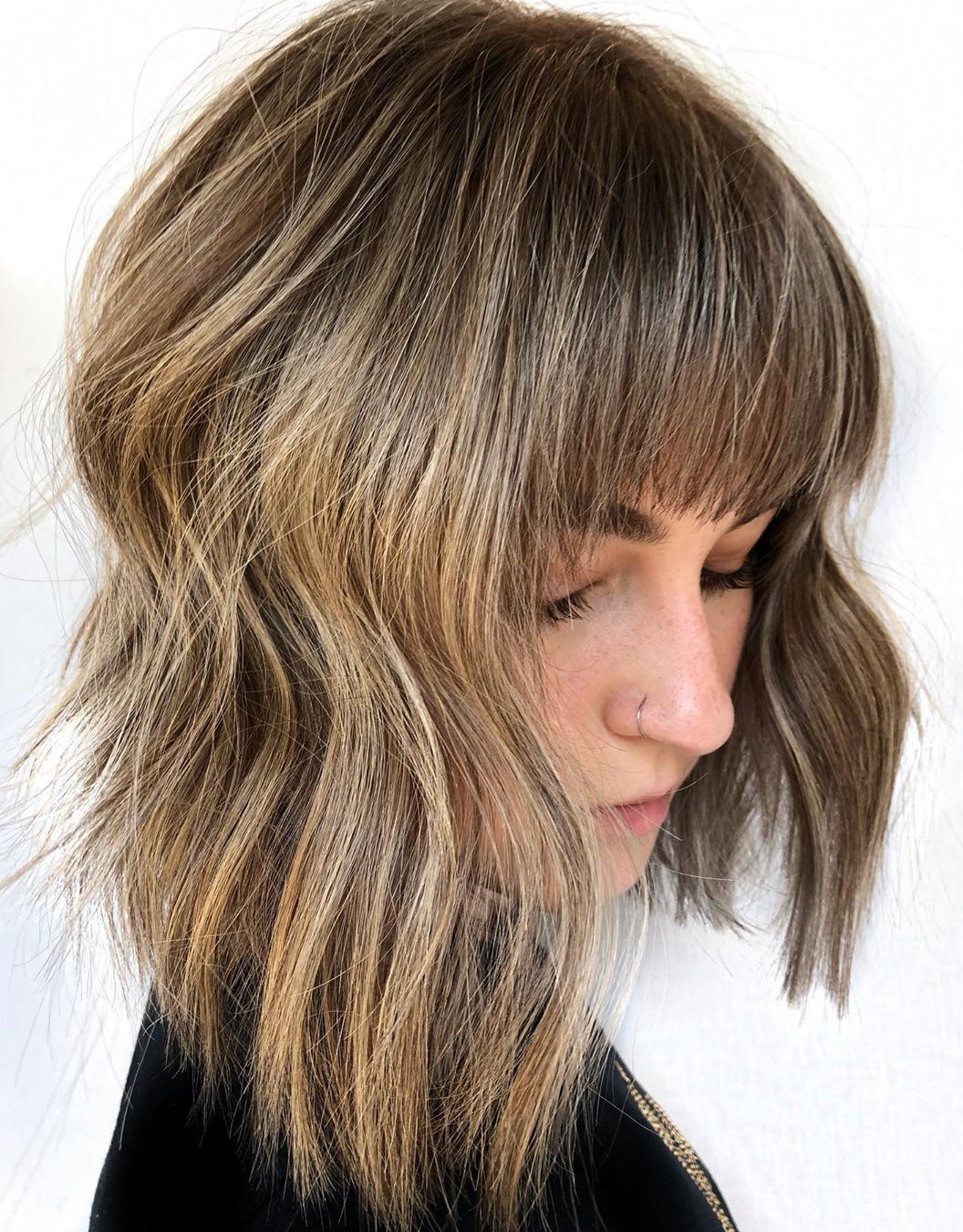 Medium Shag Haircut with Balayage Highlights