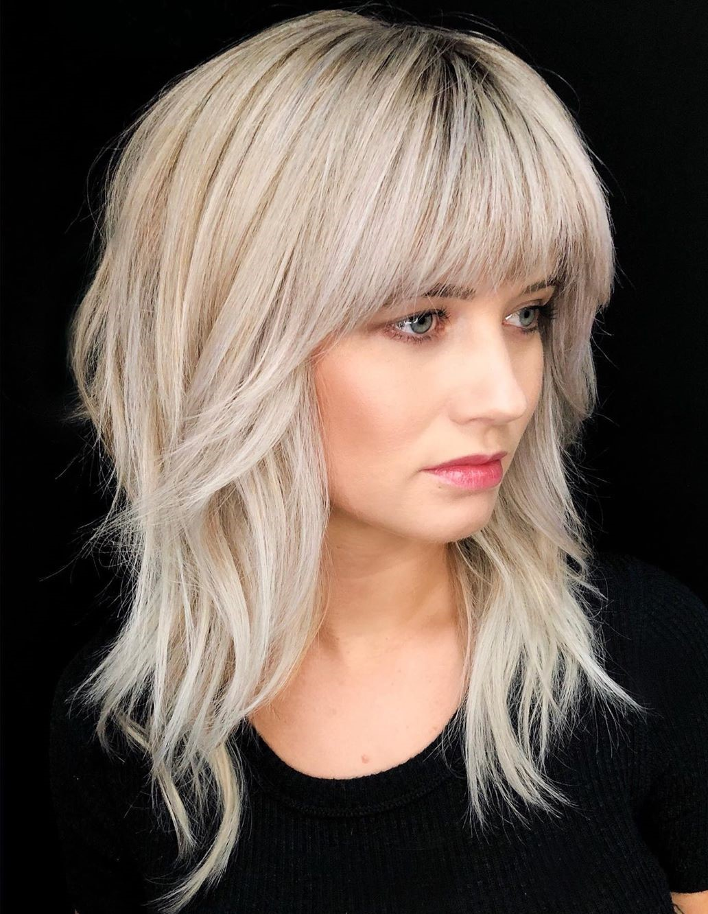 Medium Haircut with Bangs for Women
