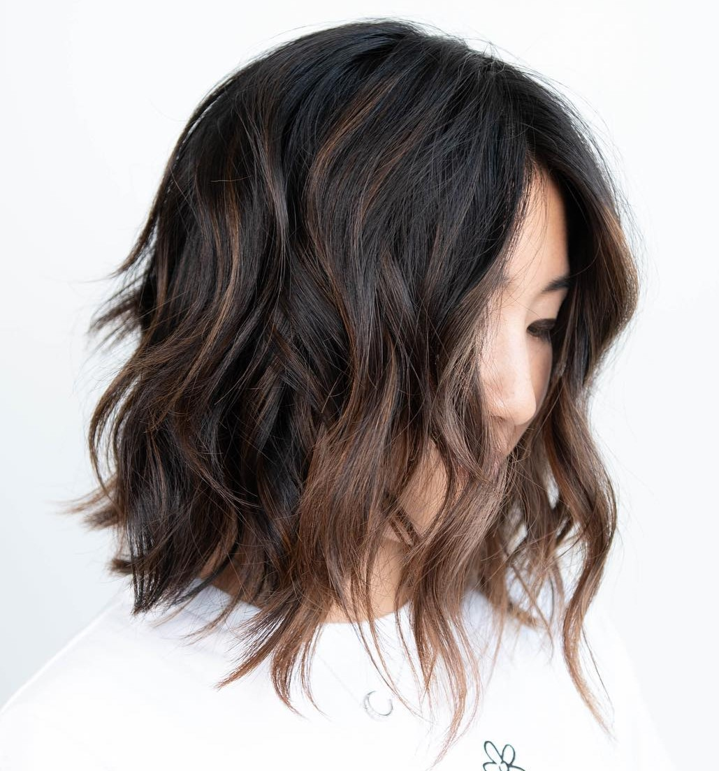 Mid-Length Wavy Lived-in Hairstyle