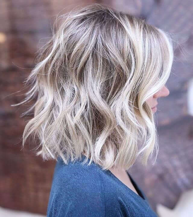 Flirty Ash Blond Highlights in Soft Waves