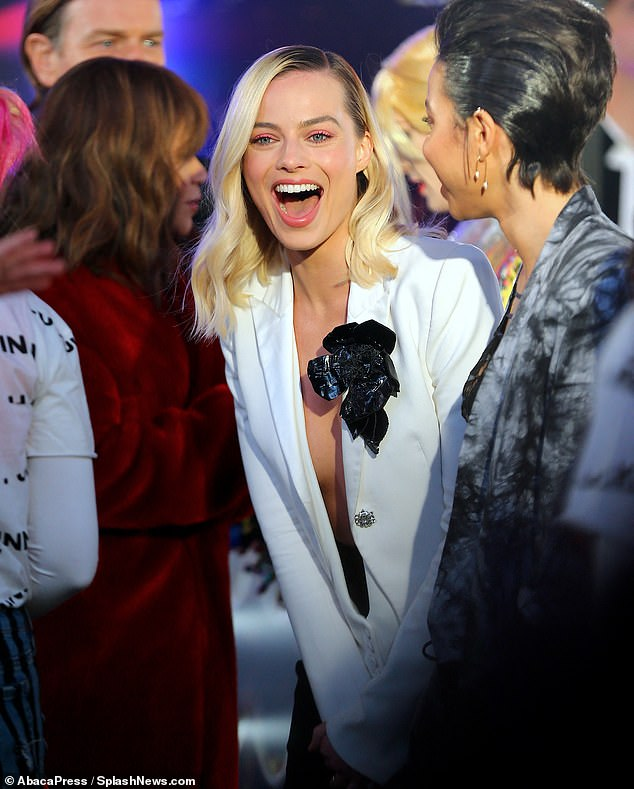 Center of it all:Margot Robbie looked every inch the sublime movie star on Tuesday, when she arrived at a promotional event for her new DC movie Birds Of Prey in Times Square
