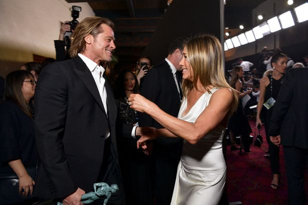 Brad Pitt and Jennifer Aniston packed on the PDA at the SAG Awards