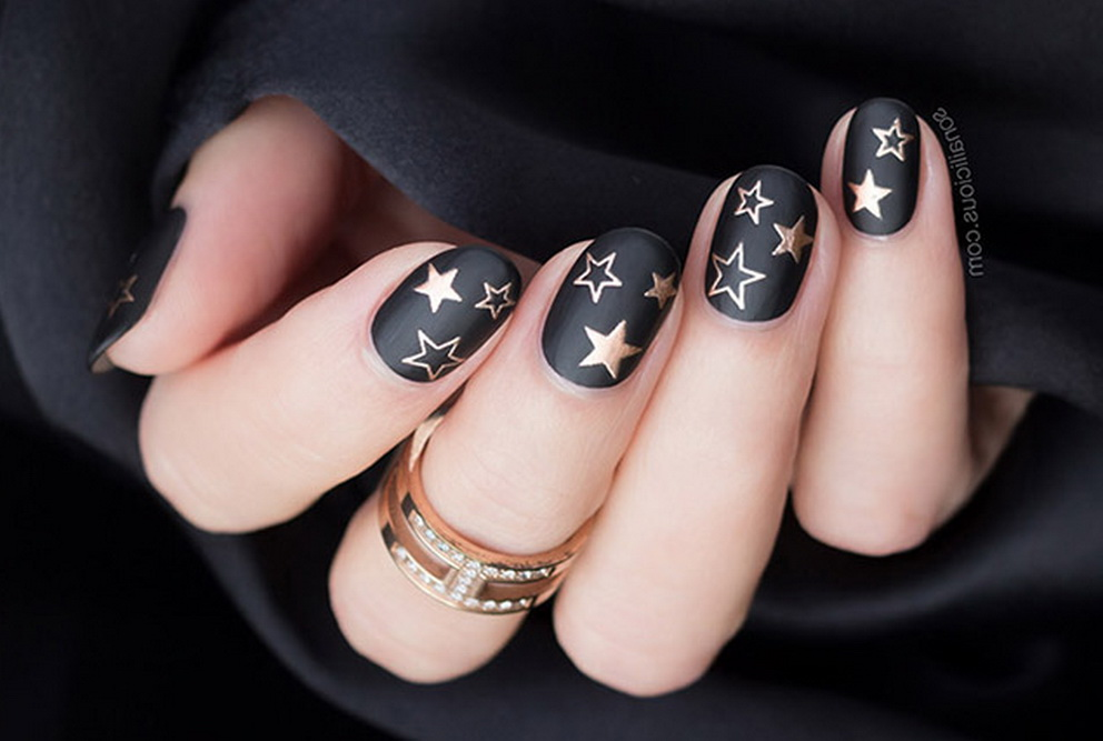 rose gold and black stars nails