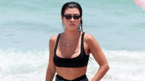 Kourtney Kardashian Poses In A Black Bikini In Her Backyard