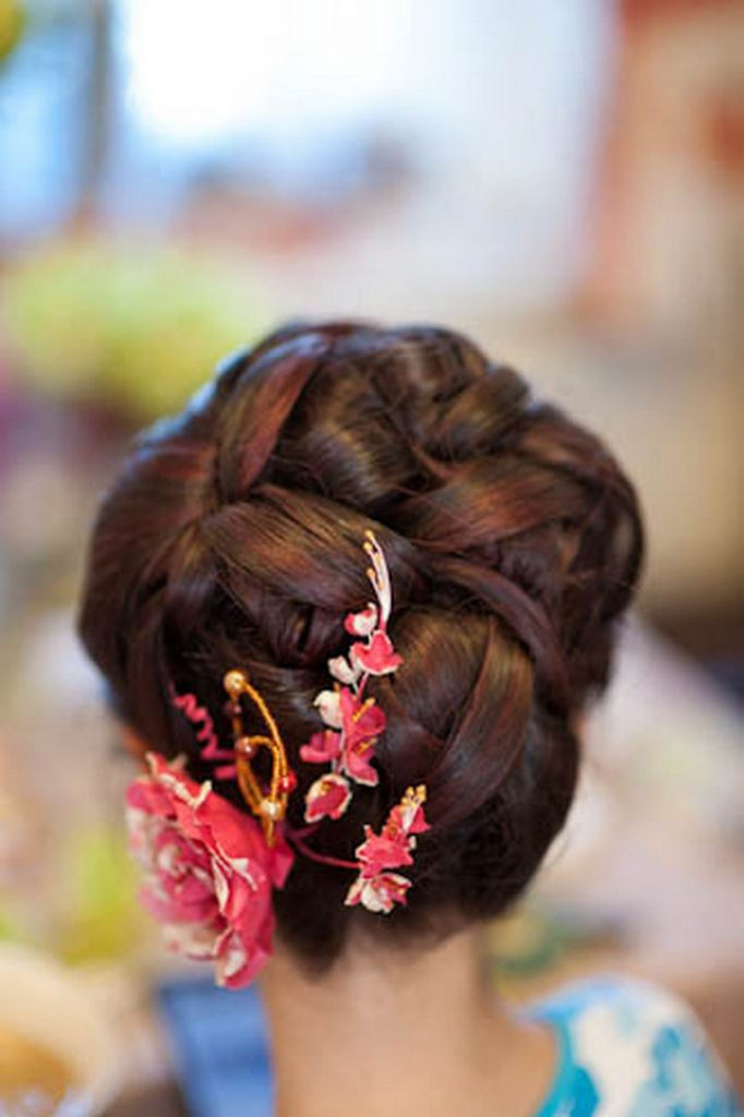 17 Disney Princess Hairstyles - A classic sleek updo with color accents.