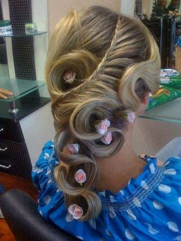 17 Disney Princess Hairstyles - A gorgeous braided style with elegant curls.
