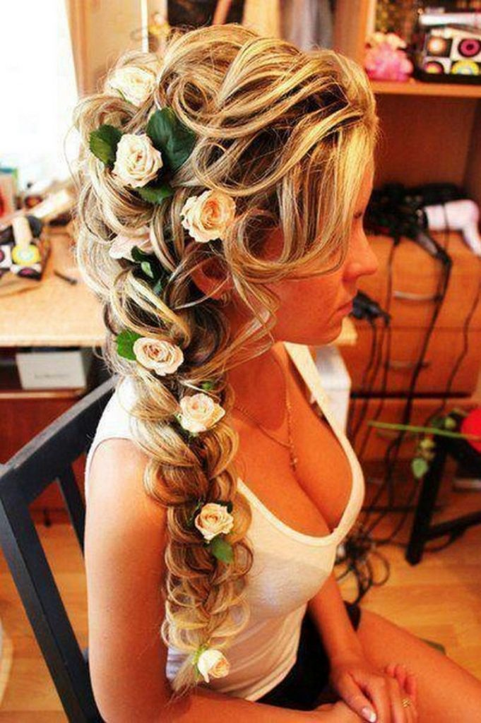 17 Disney Princess Hairstyles - A gorgeous braid intertwined with roses inspired by Queen Elsa.