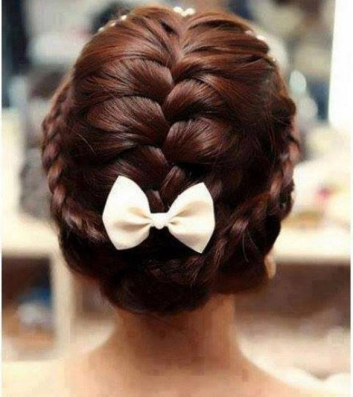 17 Disney Princess Hairstyles - A gorgeous braided updo.