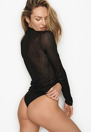Peachy:Gazing seductively over her shoulder, Candice flaunted her toned behind while clad in a black thong and sheer long-sleeved top