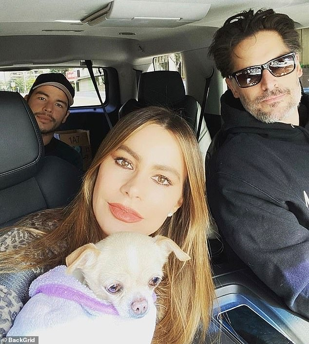 Family matters: Vergara has been quarantining with her husband Joe Manganiello at their home in Beverly Hills; the couple are pictured with her son Manolo Gonzalez Vergara