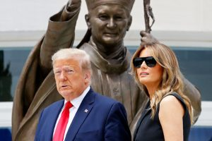 Donald Trump tell Melania Trump to smile during their visit to Saint John Paul II