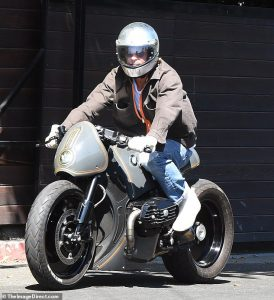 Brad Pitt looks amazing in a brownish coat as he leaves his ex-spouse Angelina Jolie's house on his bike