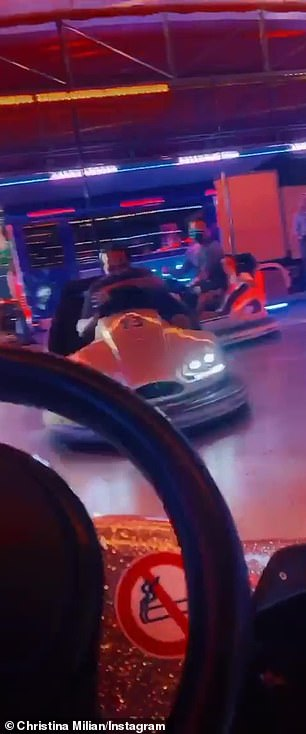 Fun never ends: On Monday night the family hit a fairground for a ride on bumper cars