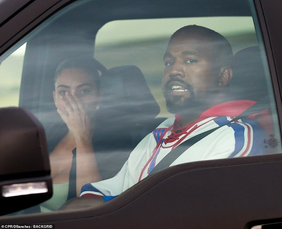 Showing the strain:The pair - who share children North, seven, Saint, four, Chicago, two, and Psalm, one - both looked on edge as they were seen leaving a Wendy's fast-food restaurant in Wyoming where he owns a $14 million ranch