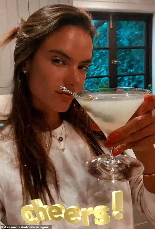 Bottoms up: Meanwhile, she flexed her mixology muscle, concocting some 'quarantinis' for an at-home happy hour