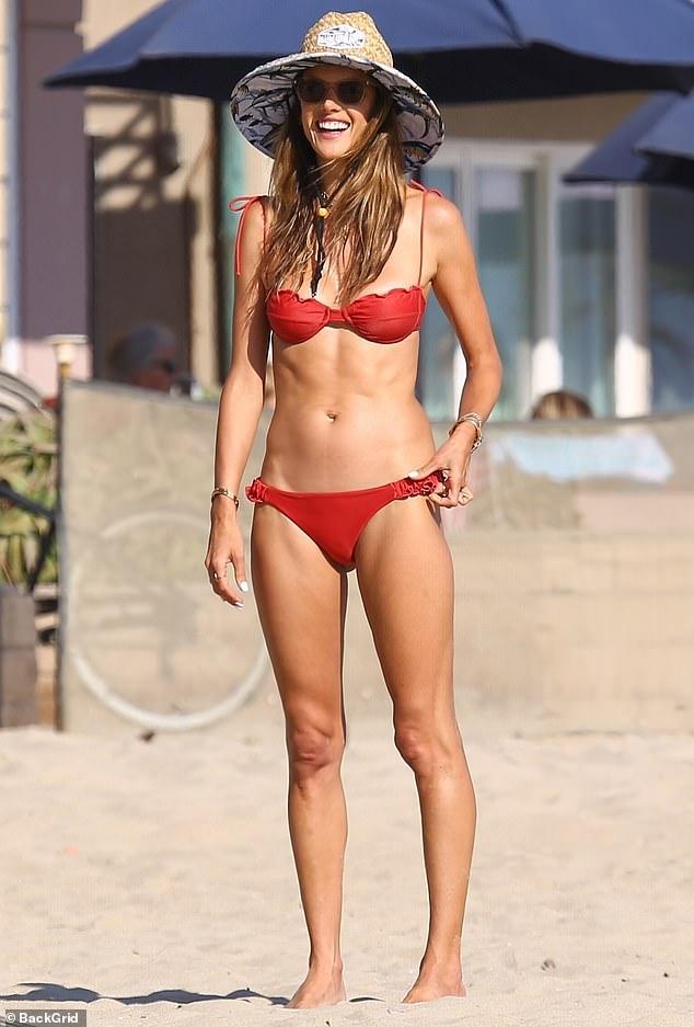 Alessandra Ambrosio flaunts sensational body in red swimwear at coastline with friends in Marina del Rey