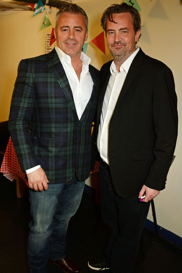 "Matt LeBlanc and Matthew Perry pose backstage following a performance of ""The End Of Longing"""