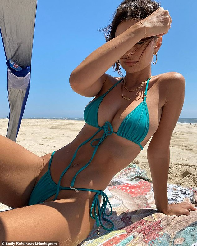 Emily Ratajkowski leaves little to the creativity as she places her awesome swimwear body on display screen