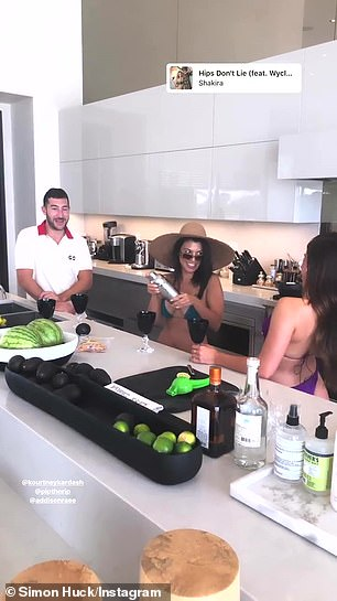 Cheers! Kourtney personally shook up cocktails in the kitchen as she chatted with her underage influencer friend
