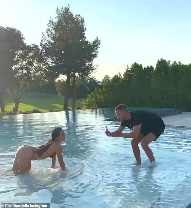 On the prowl! Later, Phil's fiancé Simon Huck (R) filmed a TikTok video of Addison as she crawled towards him in the wading part of the pool
