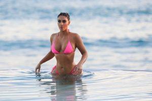 Kim Kardashian disrobe to pink swimwear in Mexico to romp alone on the coastline