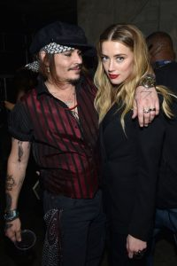 Amber Heard pounds Johnny Depp over hold-up to $ 37m lawful fight in the middle of shooting clash