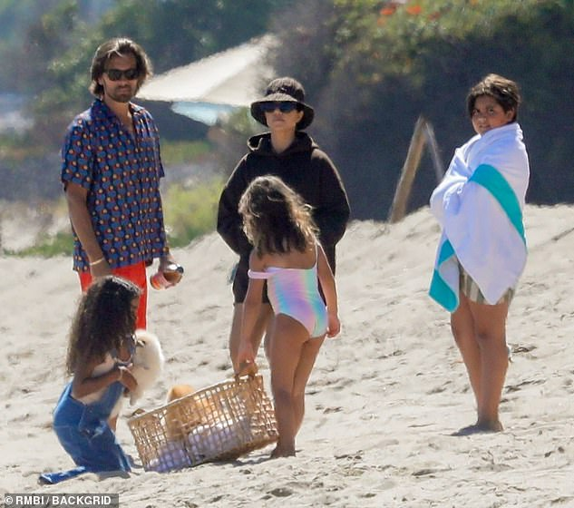 Life's a beach:Scott, Kourtney, and their three children spent a large majority of the summer at an oceanside rental property in Malibu, where they were often seen hanging out