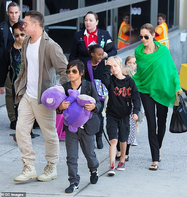 Headed to court: A trial has been scheduled for October in Los Angeles where a private judge will adjudicate on the child custody and support issues that remain unresolved between Jolie and Pitt (pictured with their children in February 2014)