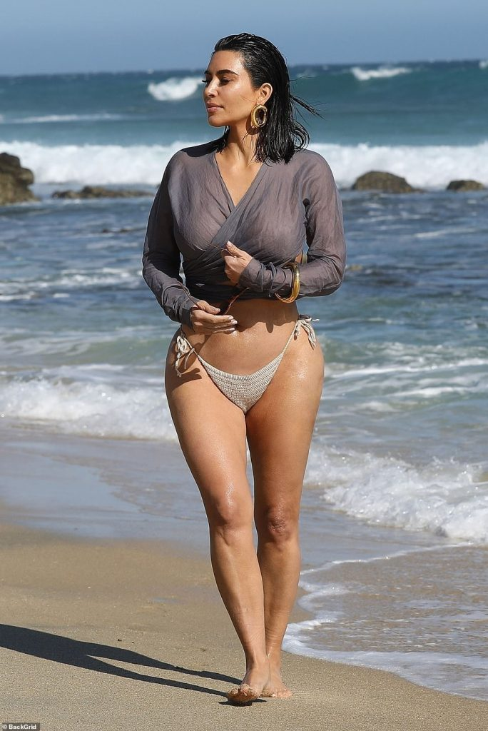 Lifted: She teamed the top with beige knit bikini bottoms that were tied with string sides pulled up above her hips and again showcasing her curves