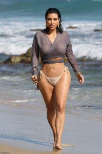 Kim Kardashian shows off her body in bikini bottoms